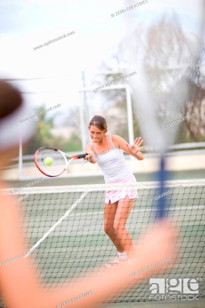 Stock Photo: Serious girl playing tennis.
