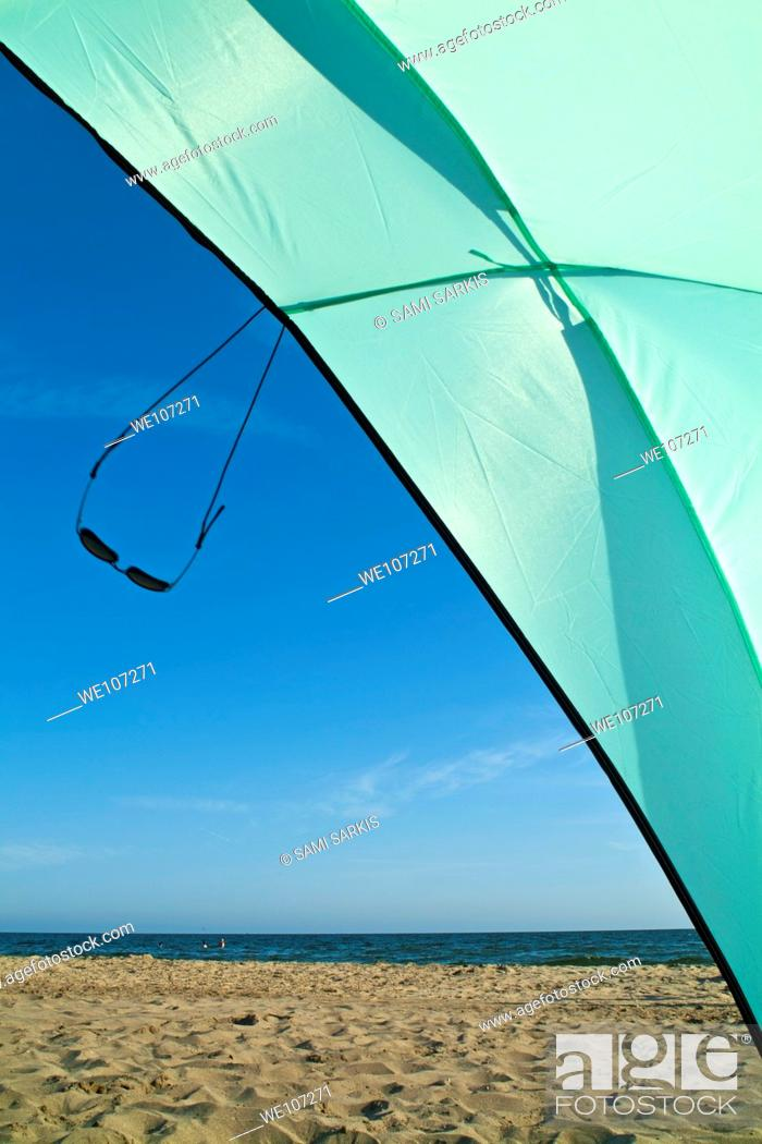 Stock Photo: Sunglasses swinging from a sun shelter at the beach, Camargue, France.