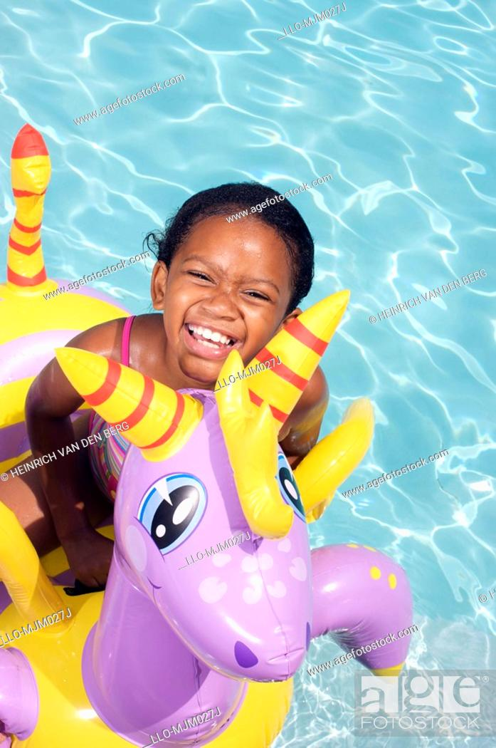 Stock Photo: Girl on floater in swimming pool, Pietermaritzburg, KwaZulu-Natal Province, South Africa.