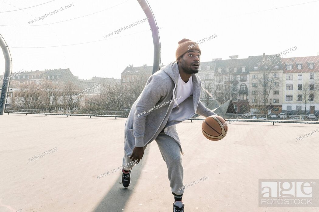 Stock Photo: Basketball player in action on court.