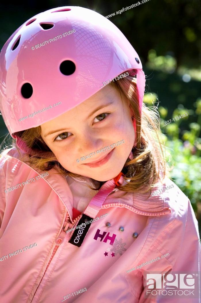 Stock Photo: Young girl with helmet.