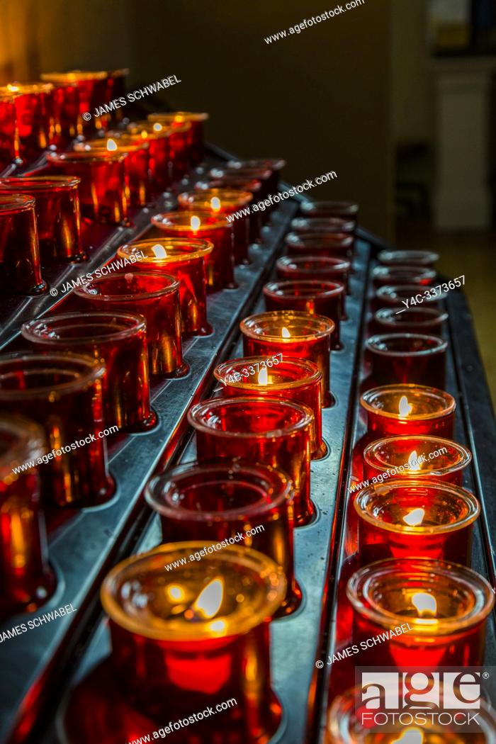 Stock Photo: Votive candles or prayer candles in St Patricks Catholic Church in Newport in County Mayo Ireland.