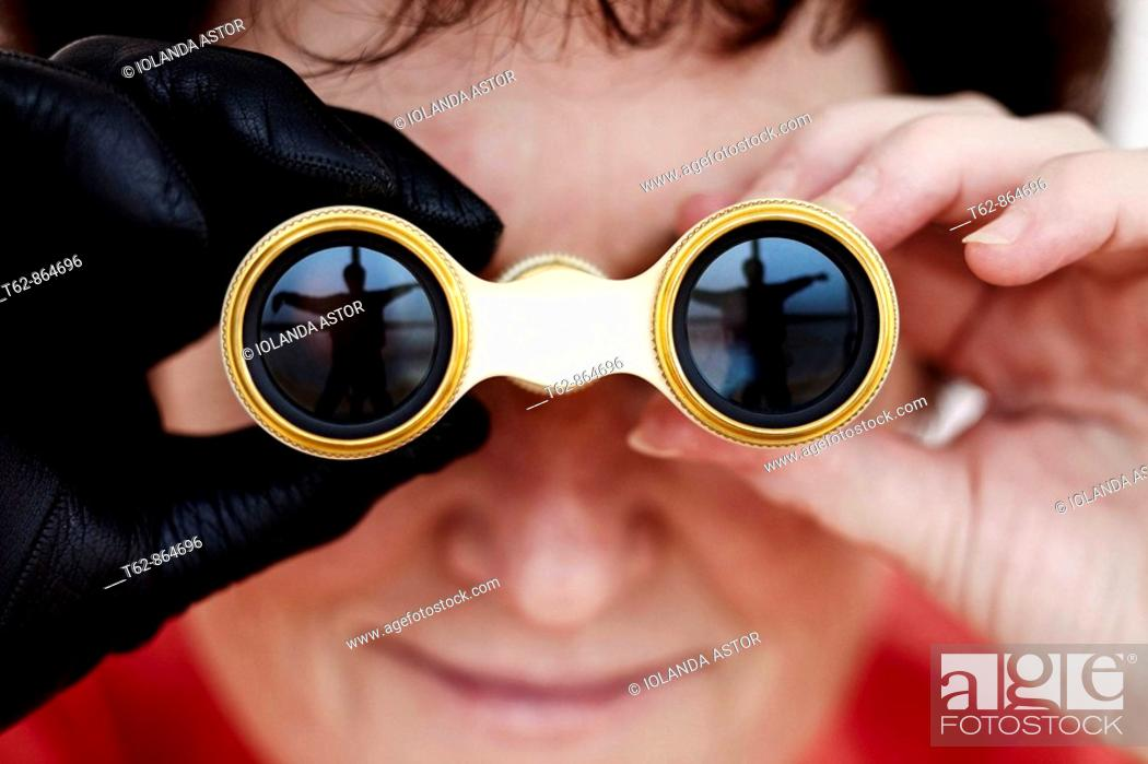Stock Photo: Close-up of woman with glasses looking at the theater.