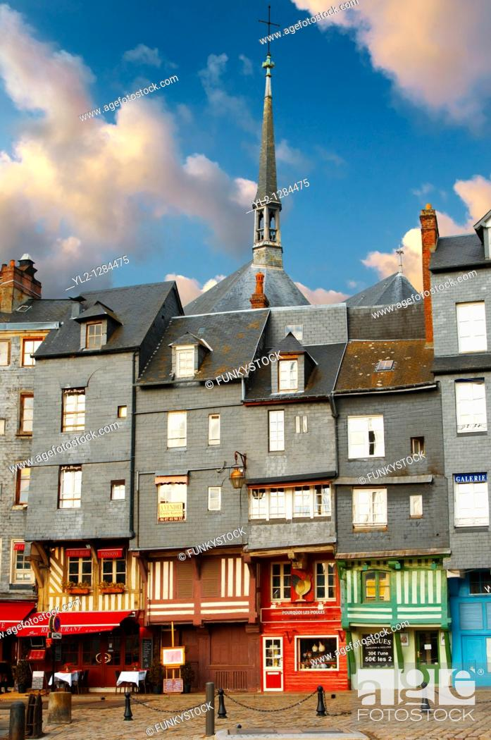 Stock Photo: Harbour sided shops with an older couple looking in the window with arms around each other  Honfleur, Normandy, France.