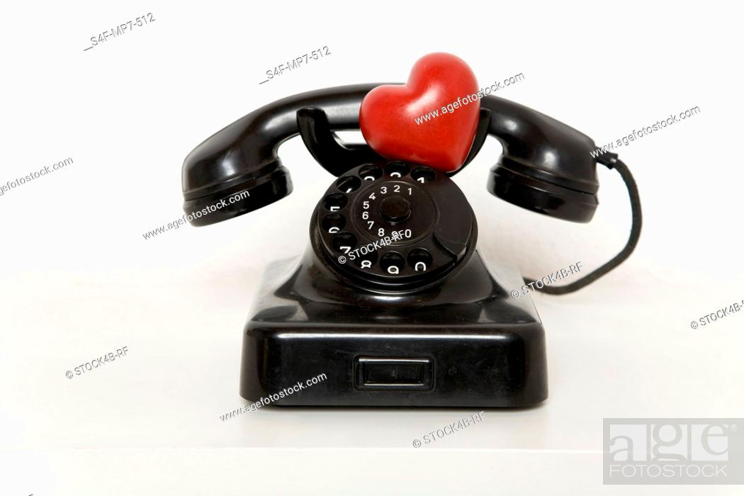 Stock Photo: Heart on old-fashioned telephone.