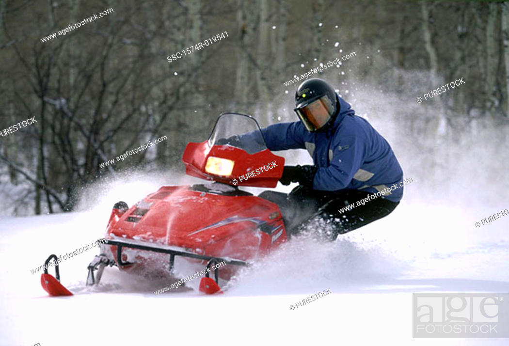 Stock Photo: Snowmobiler leaning into turn, Colorado, USA.