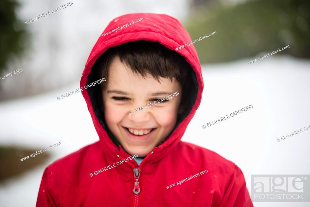 Stock Photo: portrait of smiling child with red hat in snowy forest.