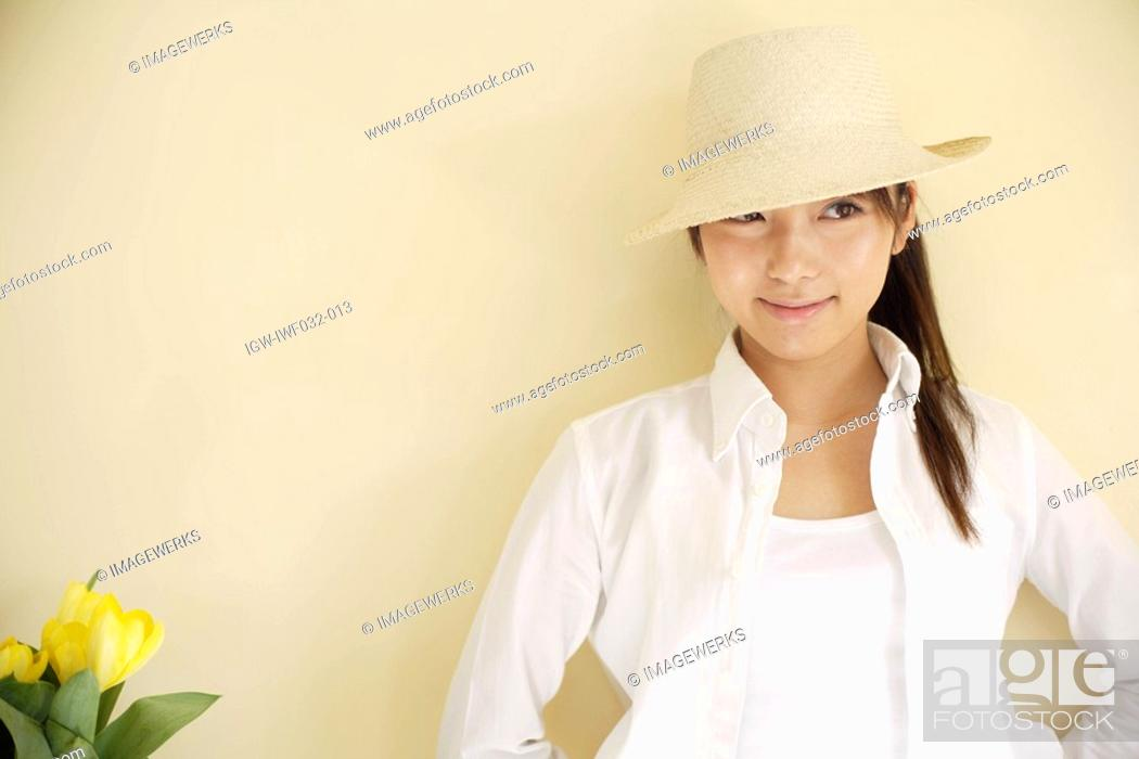 Stock Photo: A young woman wearing hat.