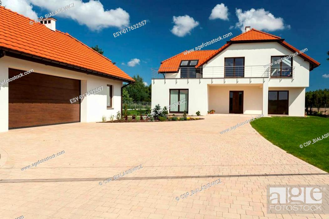 Stock Photo: Modern house and outbuilding with garage.