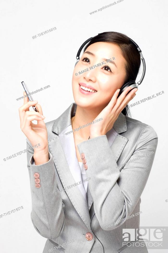 Stock Photo: businesswoman holding a pen.