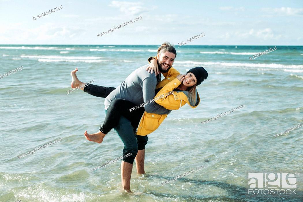 Stock Photo: Happy couple at the beach.