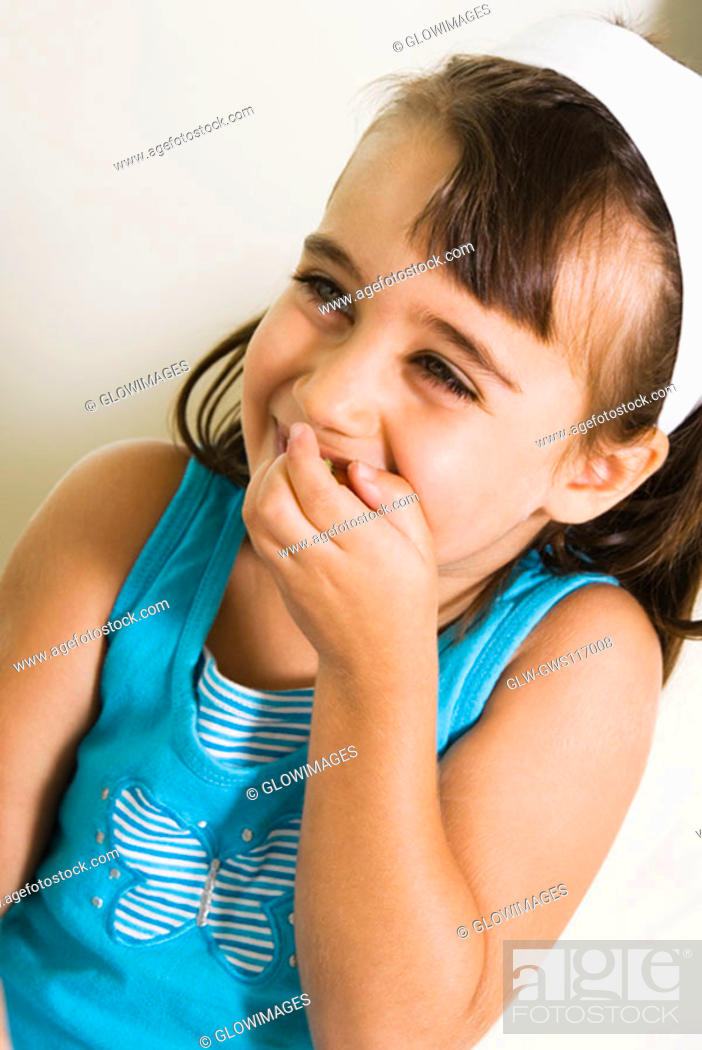 Stock Photo: Close-up of a girl smiling.