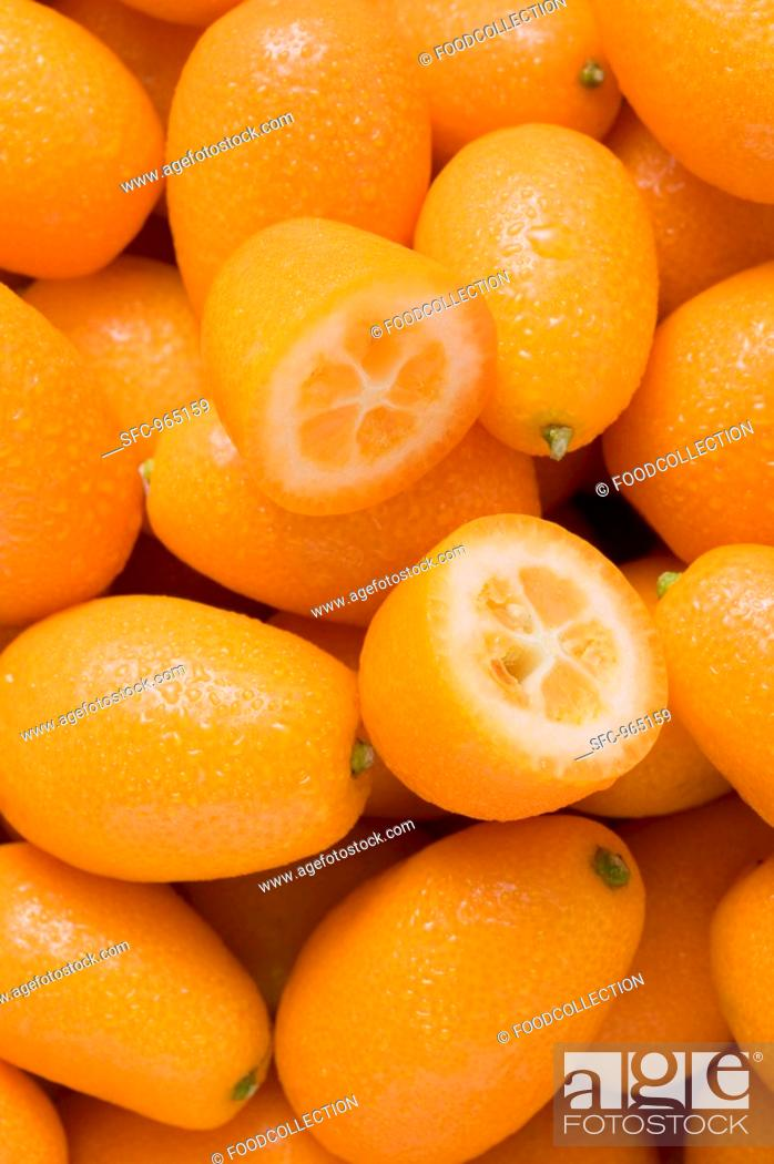 Stock Photo: Many kumquats, one halved.