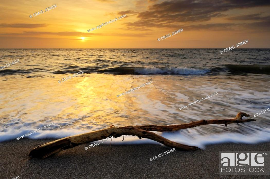 Stock Photo: Sunset at the beach at Westward Ho! on the North Devon coast, England, United Kingdom.