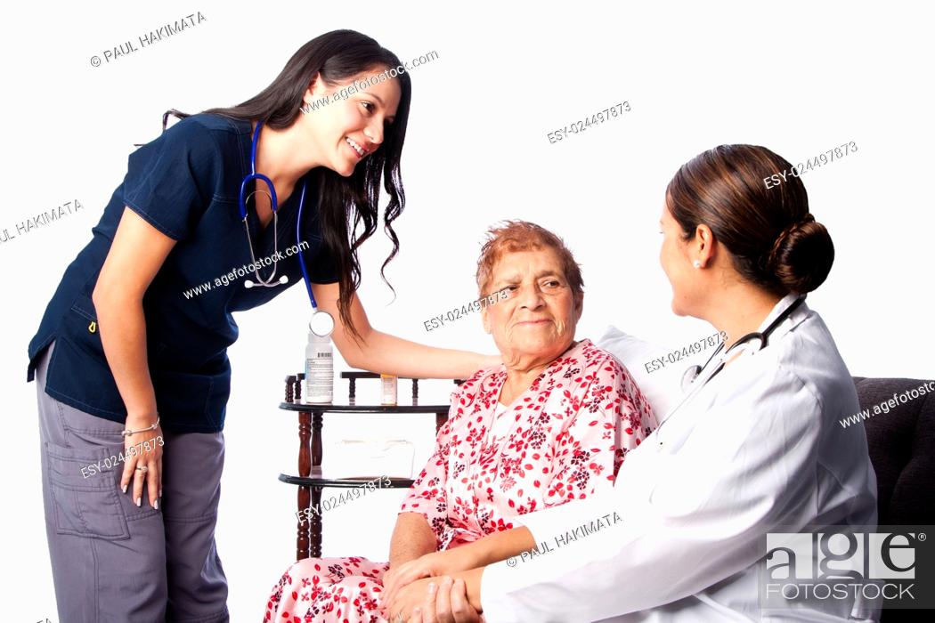 Stock Photo: Doctor and Nurse consulting comforting Senior Patient at home health.