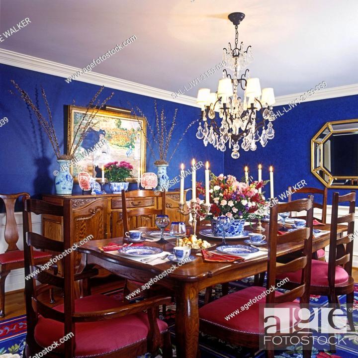 Stock Photo Dining Rooms Royal Blue Sponged Walls With White Chair Rail And Dado Oak Table Side Board Crystal Chandelier Shades