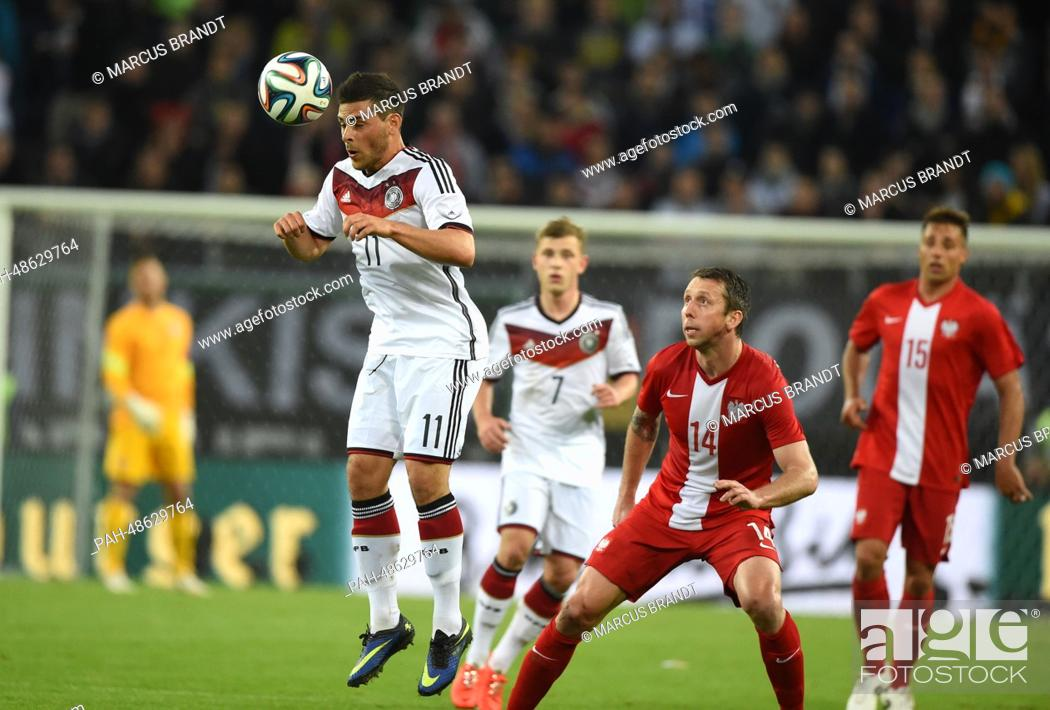 Germany's Kevin Volland (L) vies for the ball with Poland's Jakub