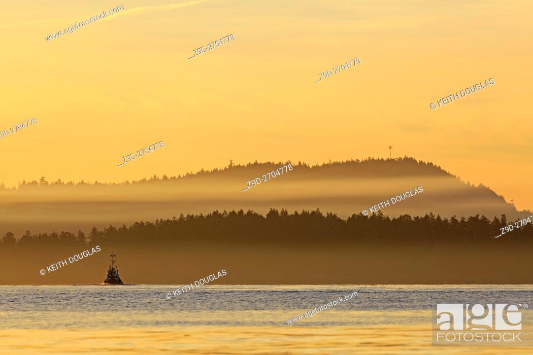 Stock Photo: Tugboat leaving harbour in morning, Nanaimo, Vancouver Island, British Columbia.