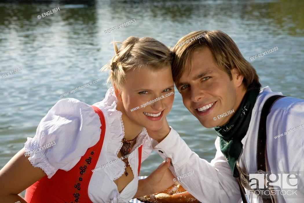 Stock Photo: Young couple in traditional Bavarian outfit, portrait, Munich, Germany.