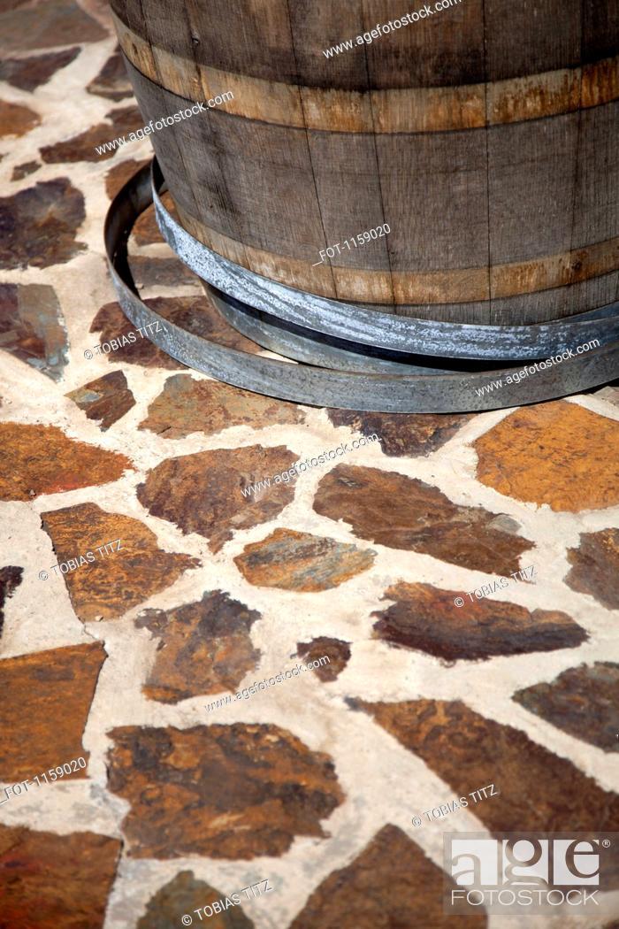 Stock Photo: Barrel on paving stone floor.