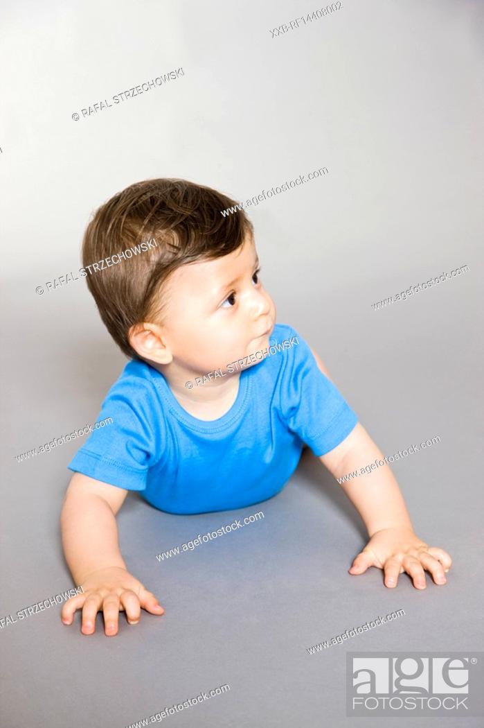 Stock Photo: Baby lying on floor.