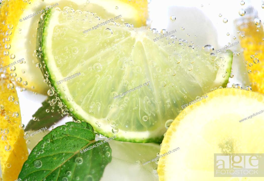 Stock Photo: Detail of jug with fresh fruit lemonade.