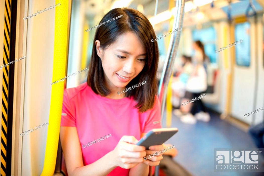 Stock Photo: Woman use smart phone inside train compartment.