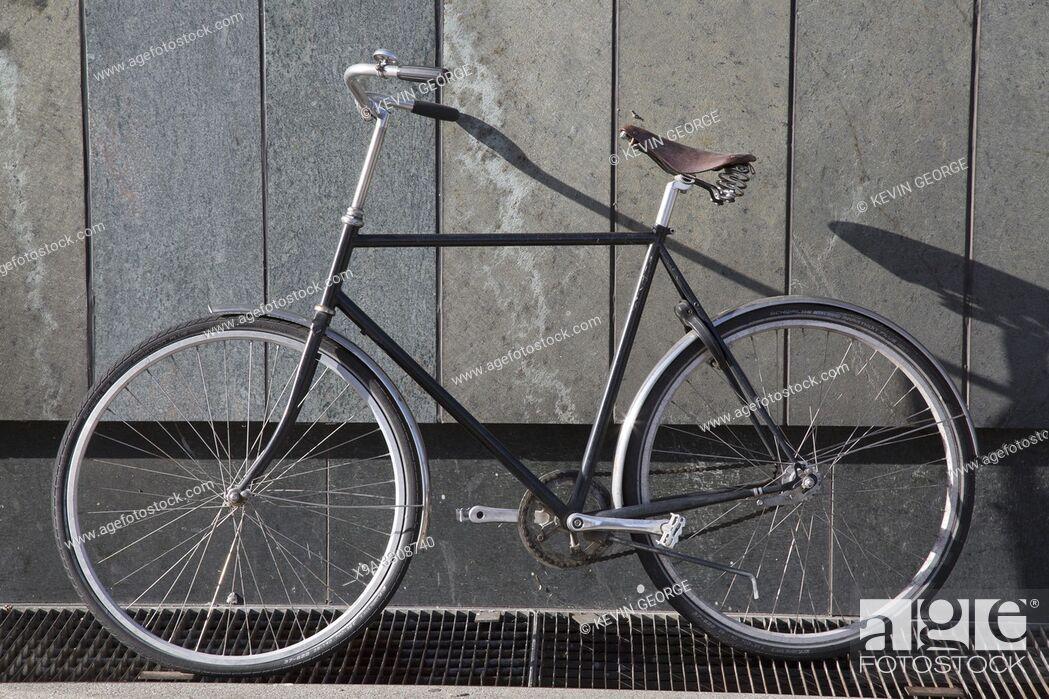Stock Photo: Bike against Wall, Copenhagen, Denmark.