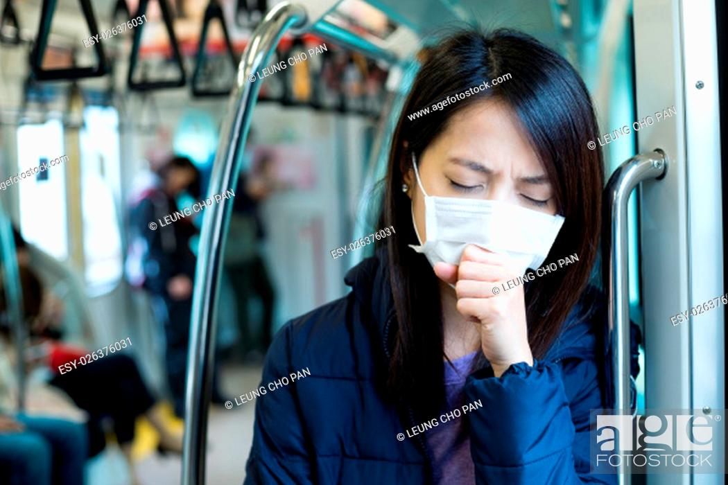 Stock Photo: Woman feeling unwell in train compartment.