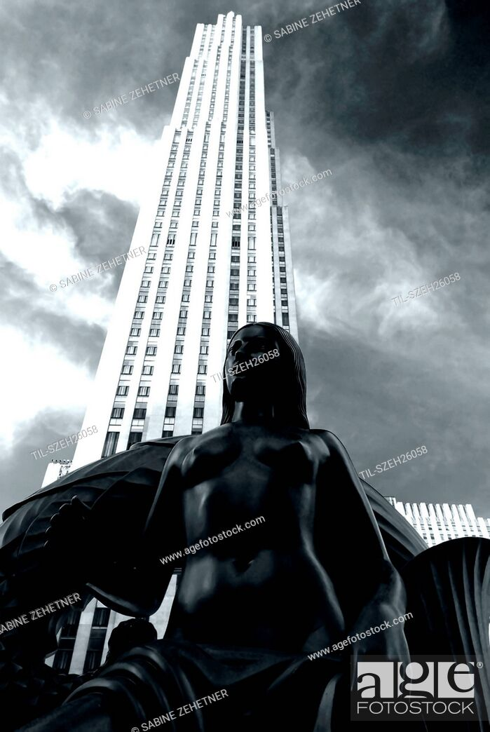 Stock Photo: Black and white of a bronze statue in front of Rockefeller Center, Manhattan, New York City.