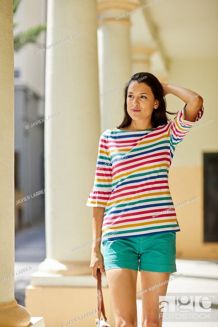 Stock Photo: Young woman walking, Pasaia, Gipuzkoa, Basque Country, Spain, Europe.