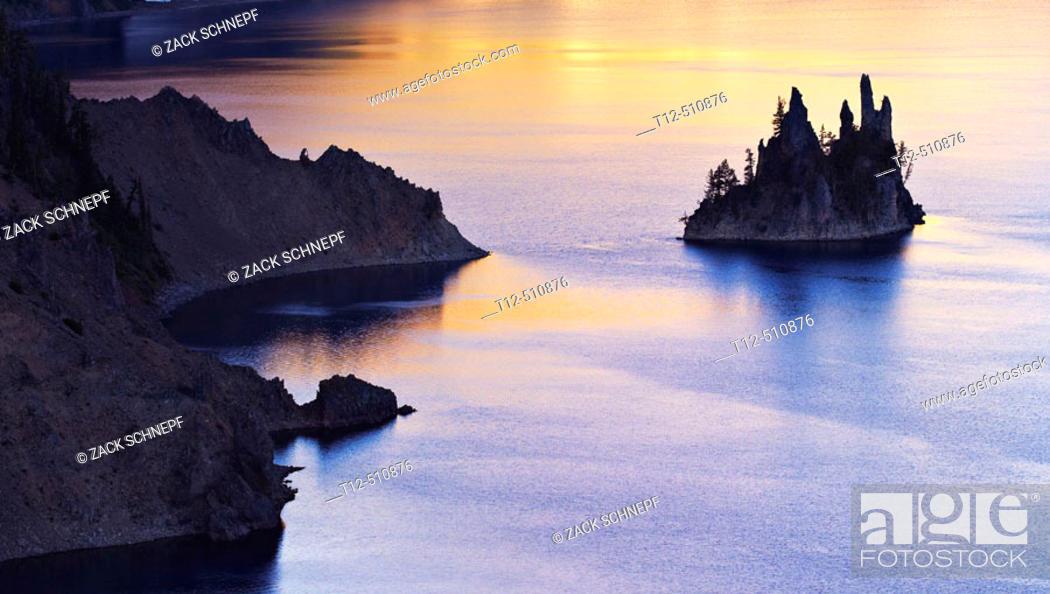 Stock Photo: The Phantom Ship in Crater Lake, Oregon, at sunrise.