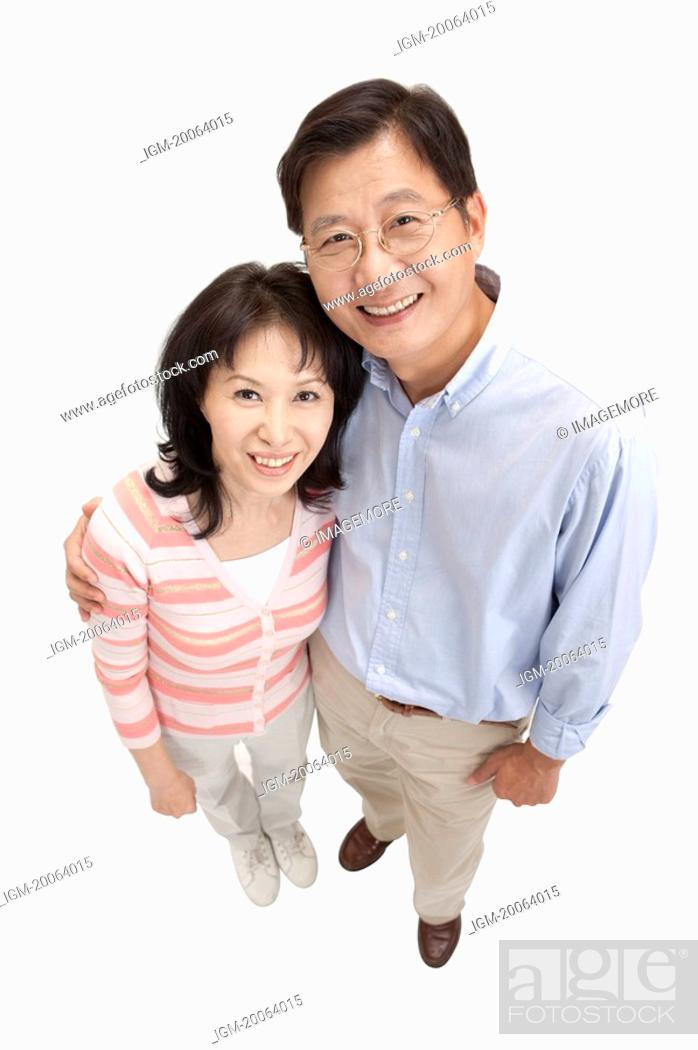 Stock Photo: Couple, Couple bonding together and looking up with smile.