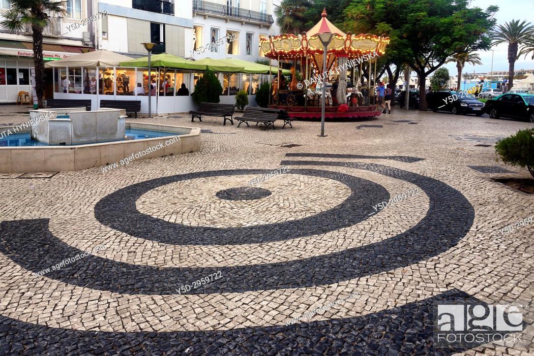 Stock Photo: Calçada portuguesa in foreground, Rua da Porta de Portugal, old town of Lagos, Algarve, Portugal, Europe.