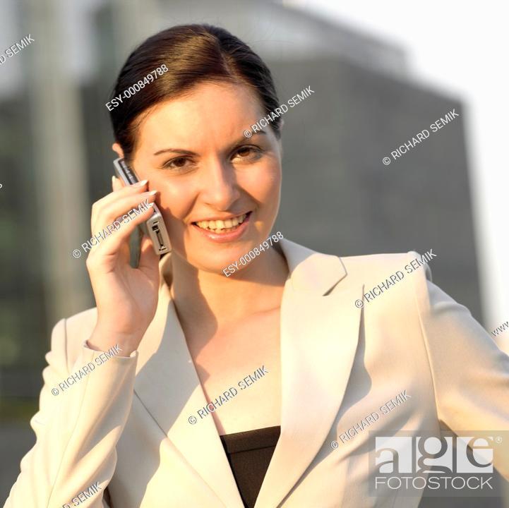 Stock Photo: telephoning businesswoman.