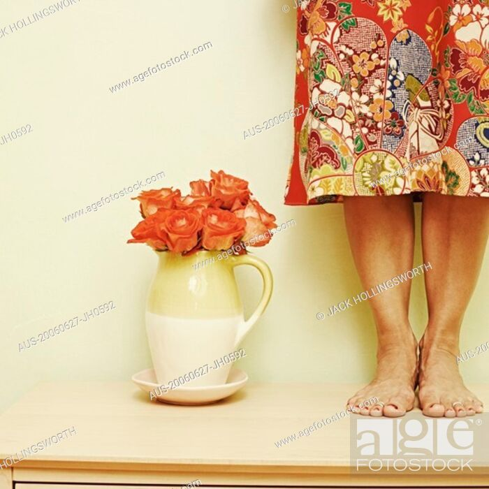 Stock Photo: Low section view of a woman standing on the table.