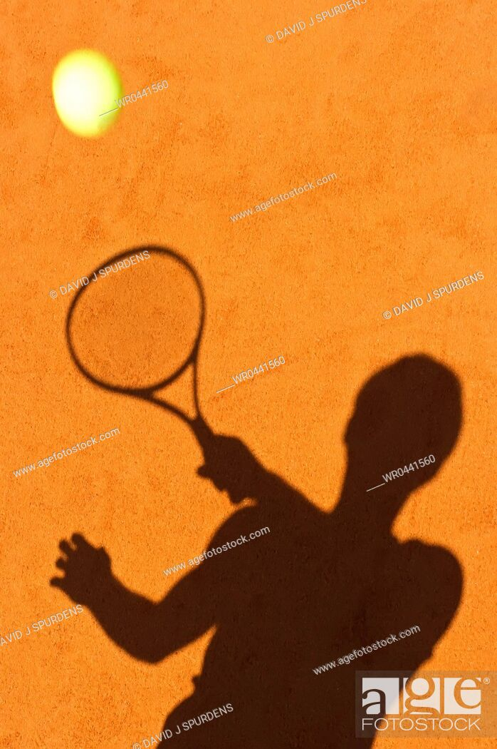 Stock Photo: The sillhoute of a tennis player returning ball.
