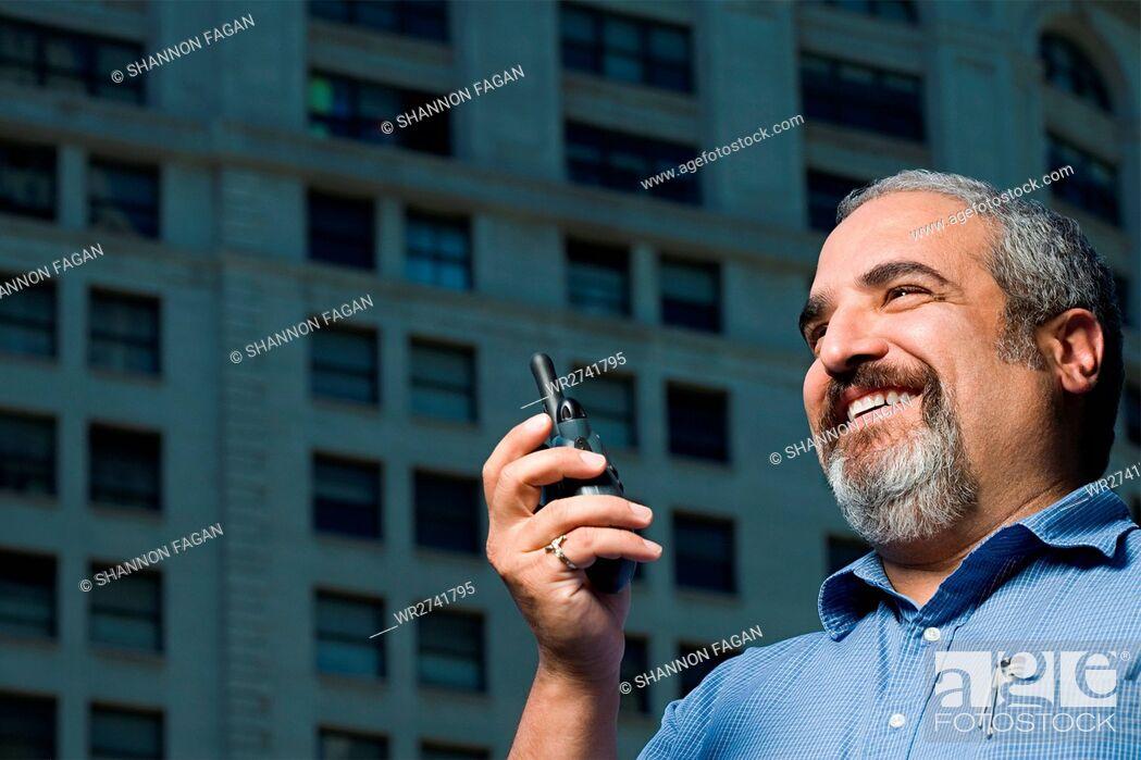 Stock Photo: Man with walkie talkie.