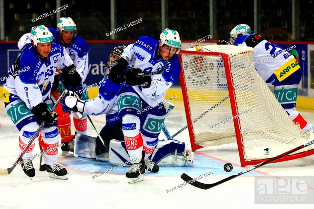 Stock Photo: Swiss Ice Hockey, ZSC-Lions vs. EV Zug. Paul DiPietro (left), Marco Maurer and Lars Weibel (goalkeeper)l from EV Zug (2007).