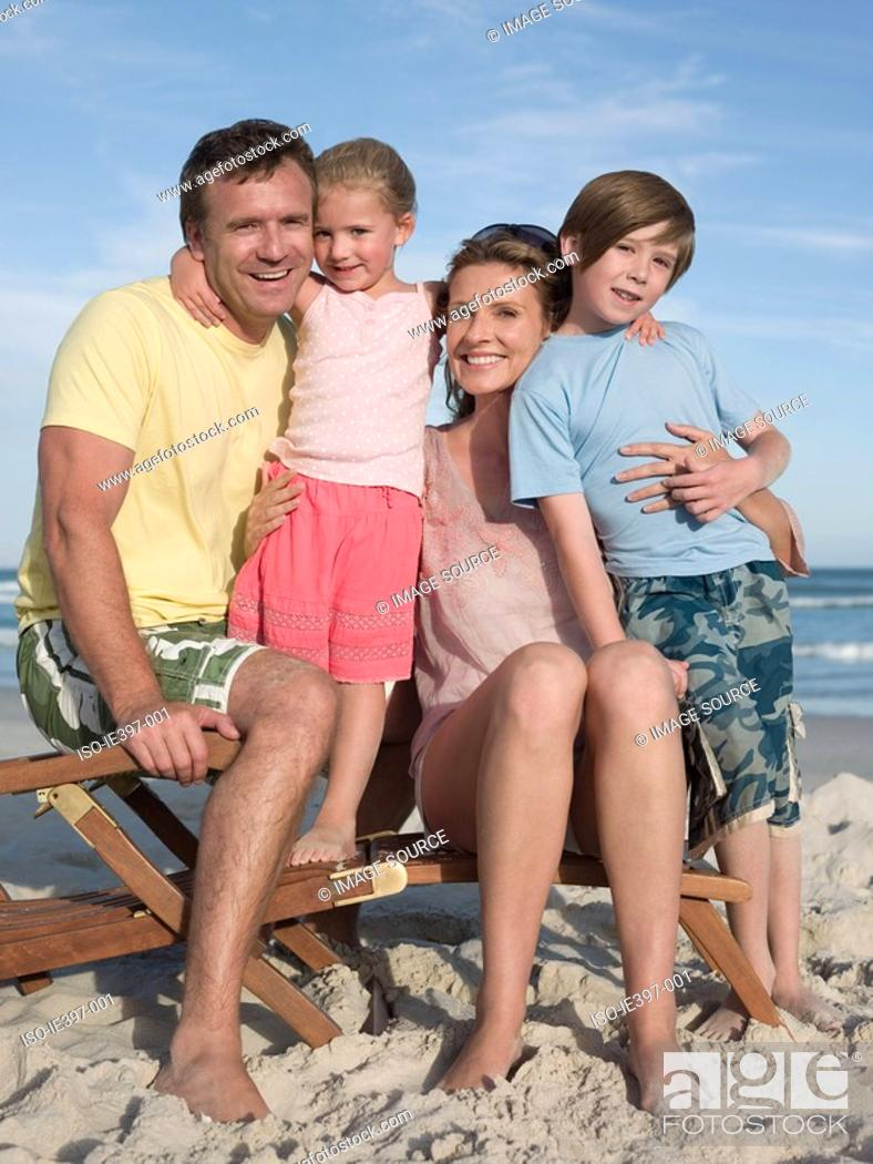Stock Photo: Family on a lounge chair.