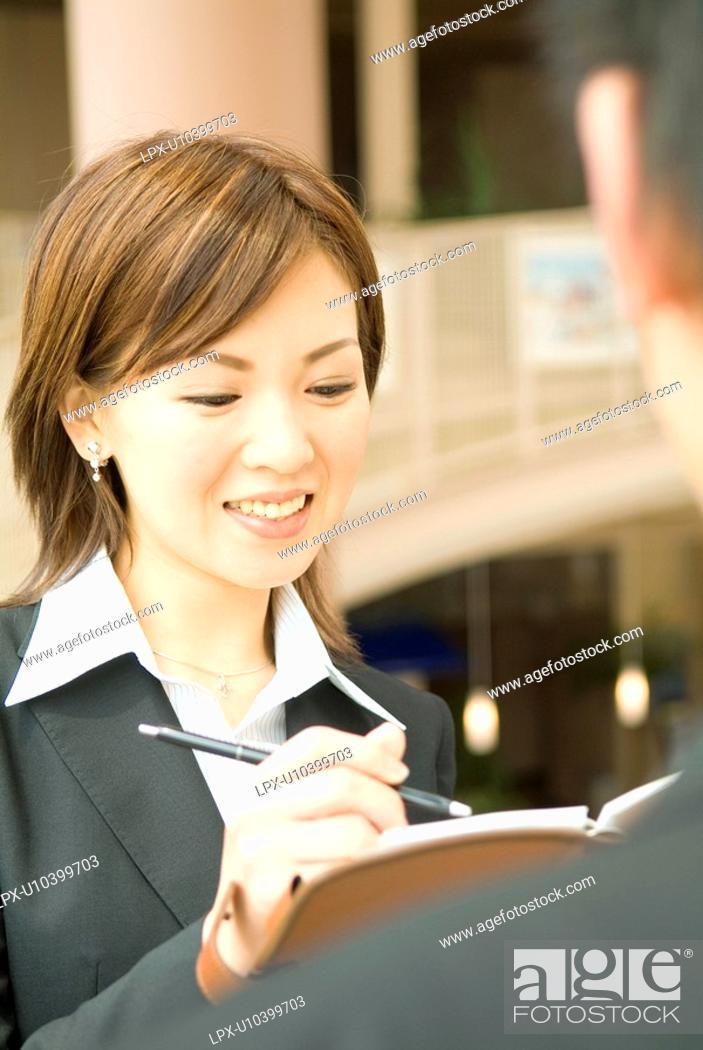 Stock Photo: The Business Woman Who Takes A Memorandum.