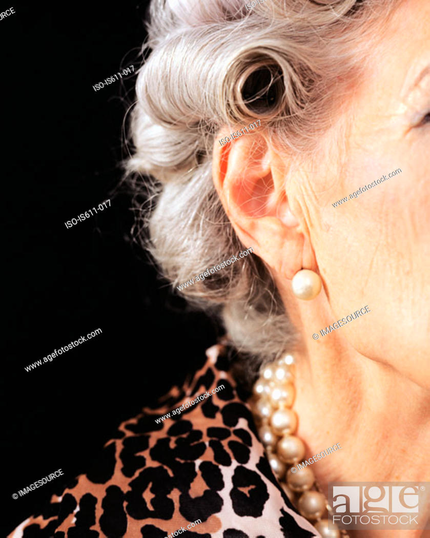 Stock Photo: The side of a senior woman's face.