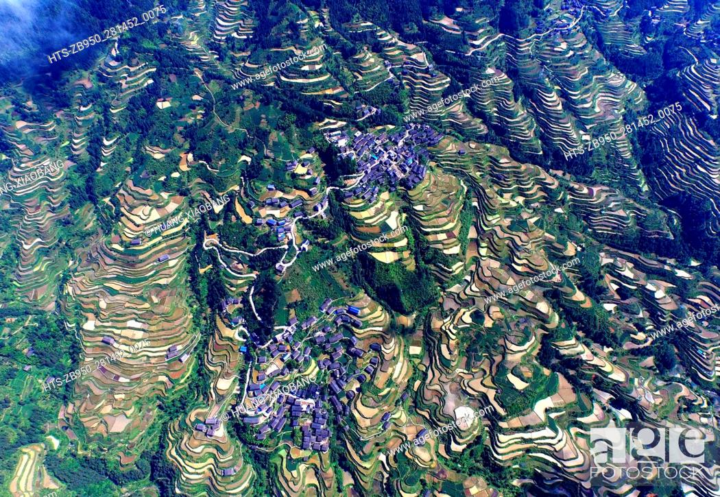 Stock Photo: (160515) -- BEIJING, May 15, 2016 () -- This photo taken with unmanned aerial vehicle on May 10, 2016 shows the Zhiliao Village in Dudong Township of Sanjiang.