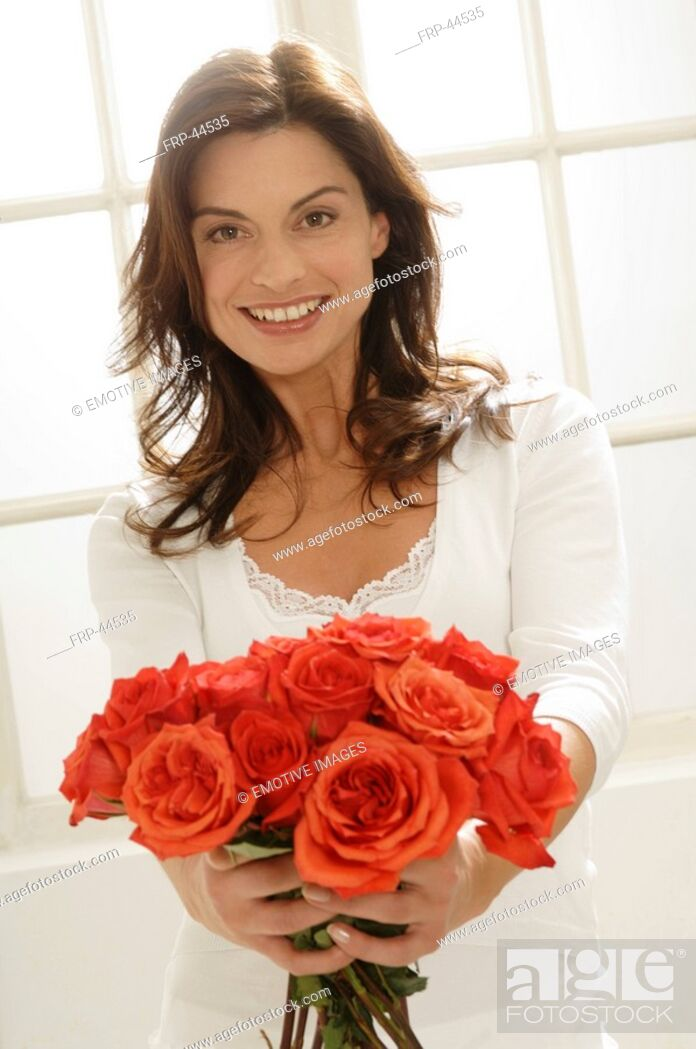 Stock Photo: Woman presenting a bunch of roses.