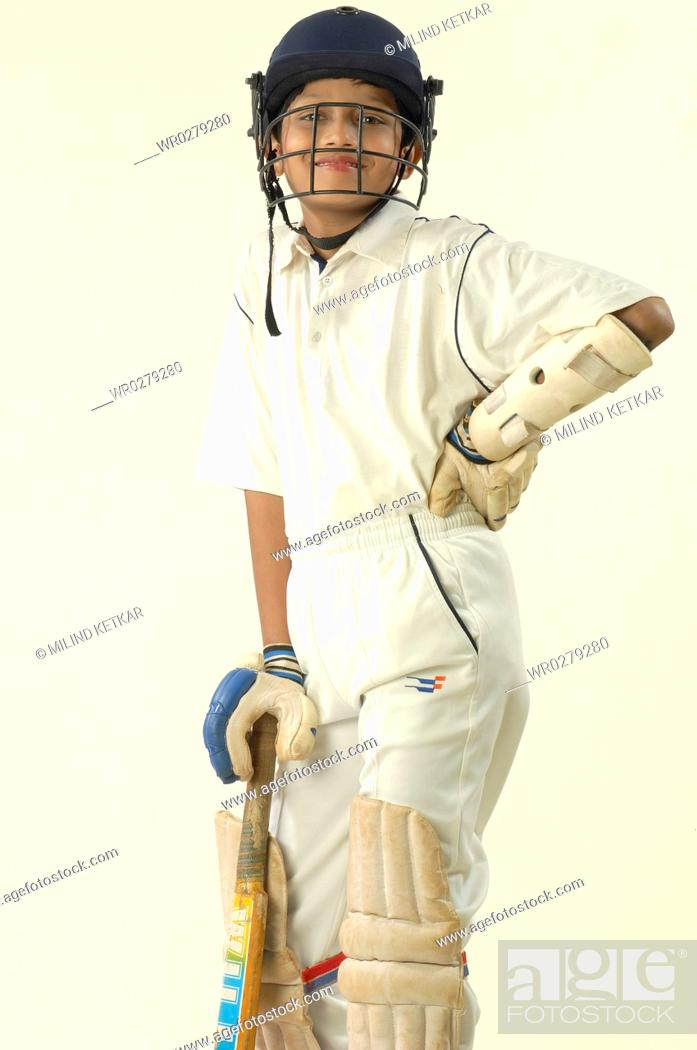 Stock Photo - South Asian Indian boy wearing cricket costume with bat in hand MR 705-N & South Asian Indian boy wearing cricket costume with bat in hand MR ...