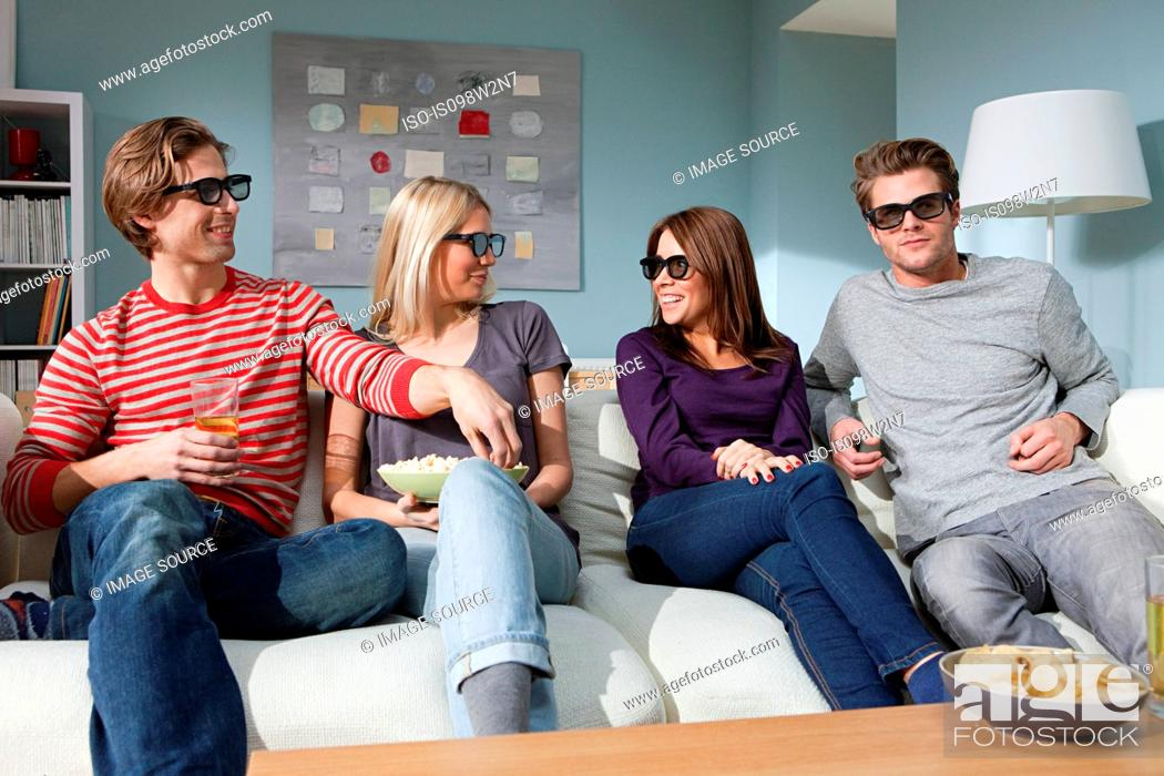 Stock Photo: Four friends watching 3d movie at home.