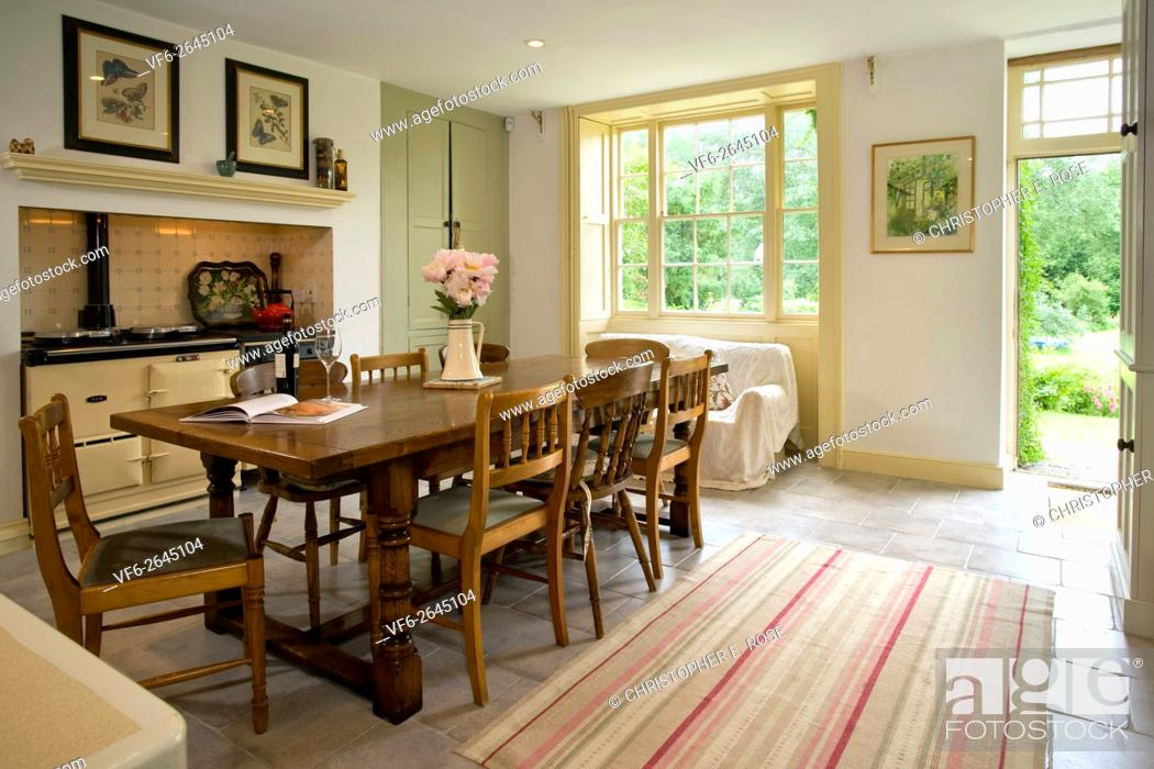 A Traditional Farmhouse Style Kitchen With Aga Cooker Back