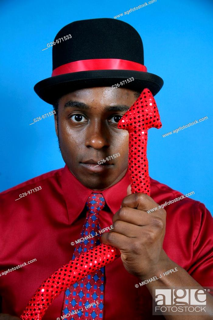 Stock Photo: Man in bowler hat with devil tail.