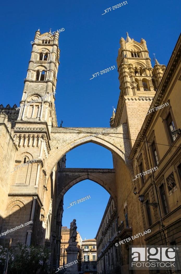 Stock Photo: The main, Southwest facade of The Cathedral, left, and its arcades connecting it to the Archbishops' Palace. Central Palermo, Sicily, Italy.