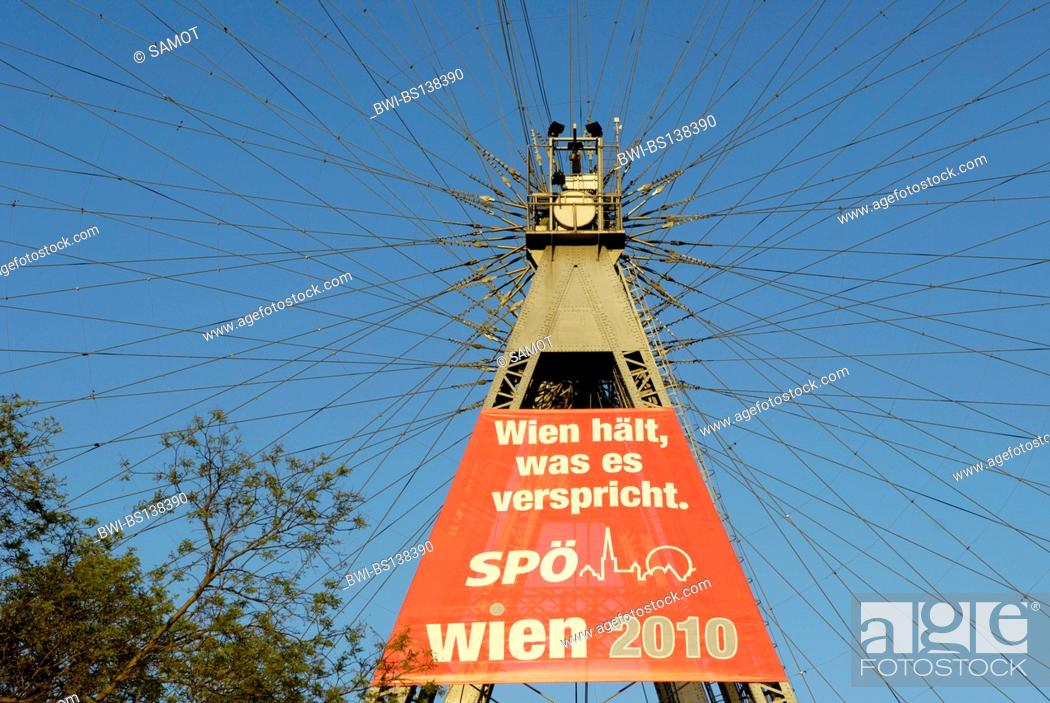 Stock Photo: amusement park Vienna Prater, advertising of a politcal party at the ferries wheel, Austria, Vienna.
